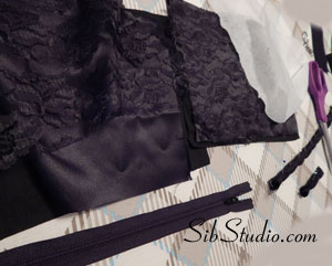 Black lace over satin wristlets
